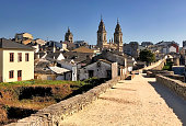 View of historic city of Lugo and St Mary church towers in Galicia, Spain, as seen from ancient defensive Roman wall that surrounds the city.