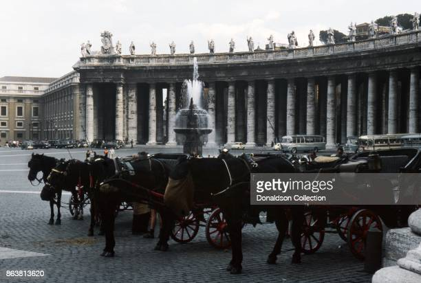 A view of horses and carriages in St Peter's Square in Vatican City on September 19 1963 in Rome Italy