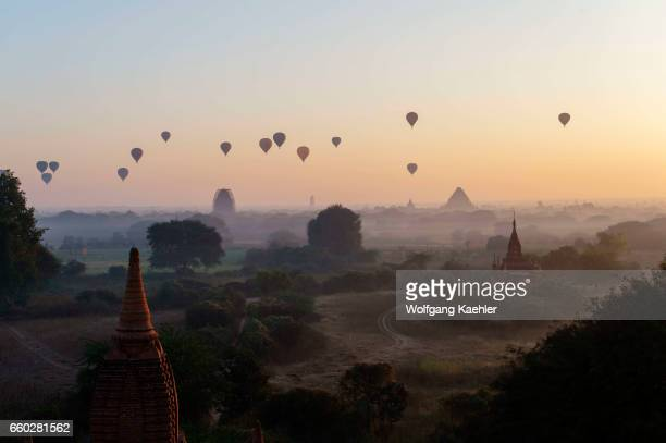 View of hot air balloons temples and pagodas before sunrise from the Shwesandaw Pagoda in Bagan in Myanmar