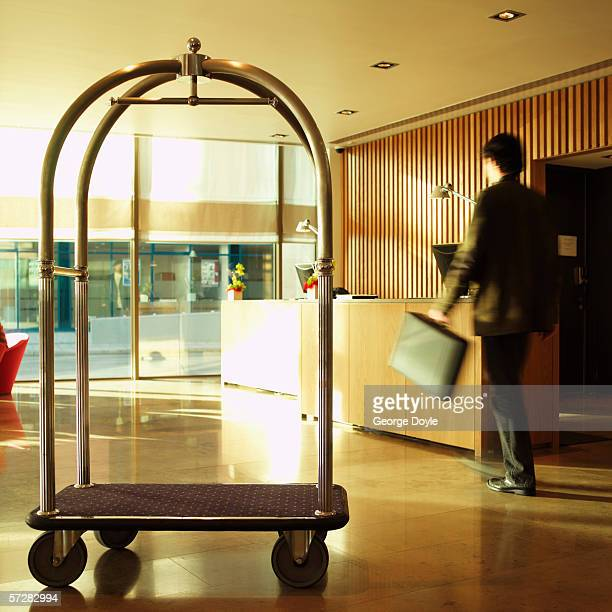 View of hotel lobby with trolley and businessman