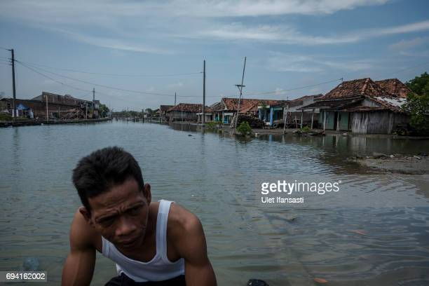 A view of houses submerged by flood waters from rising sea levels at Bedono village on June 7 2017 in Demak Indonesia Indonesia is known to be one of...