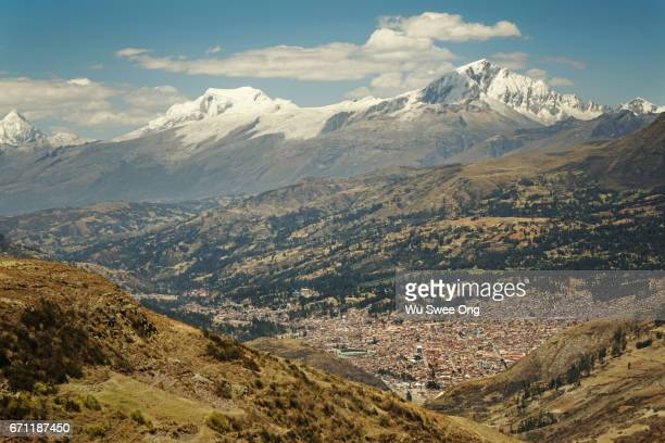 View of Huaraz town and snowcapped mountains in the background