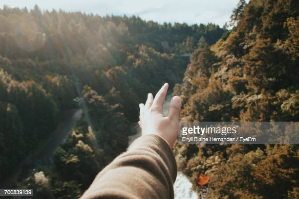 View Of Human Hand Against Mountain Landscape