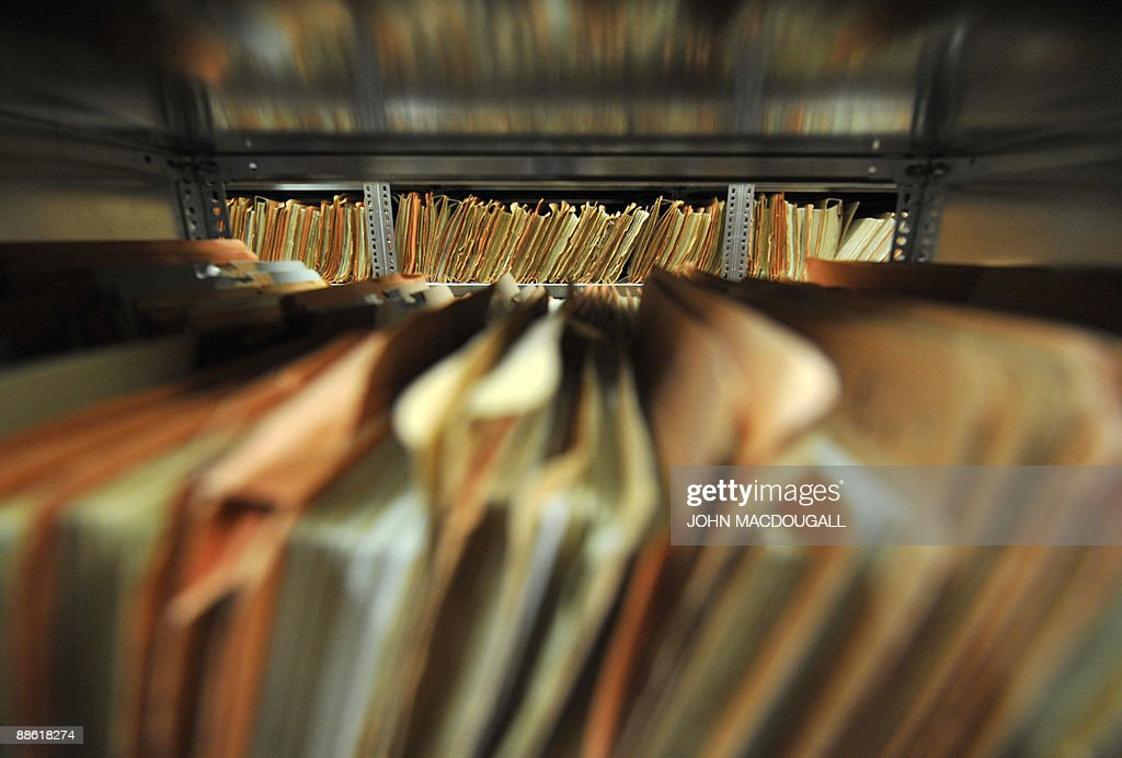 View of hundreds of documents in the archives of the former East German secret police, known as the Stasi in Berlin on June 22, 2009. The Office of the Federal Commissioner (BStU), a state-funded body which manages the archives of the former East German secret police Stasi, preserves the records of the Ministry for State Security of the GDR, making them available for various purposes to private individuals, institutions and the public in accordance with strict legal regulations. AFP PHOTO JOHN MACDOUGALL