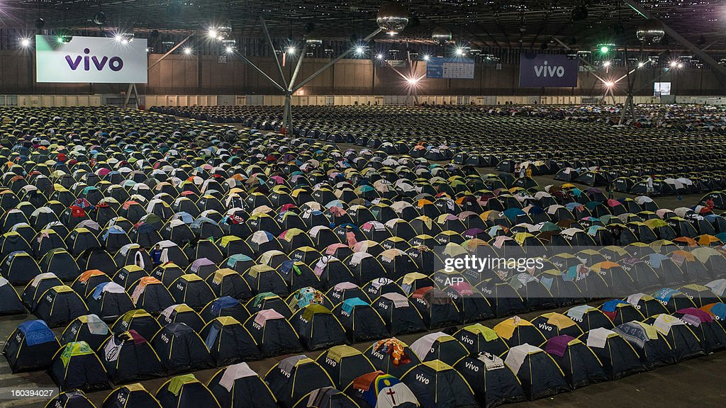 View of hundreds of tents with accommodations for 6000 people during the Campus Party event, in Sao Paulo, Brazil, on January 30, 2013. About 8,000 hackers, developers and geeks are expected to attend the annual weeklong, 24-hours-a-day technology event which first started in Spain in 1997 and now spread into various countries. AFP PHOTO/Yasuyoshi CHIBA