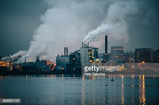 View of industrial plant and smoke stacks at night, Tacoma, Washington, USA