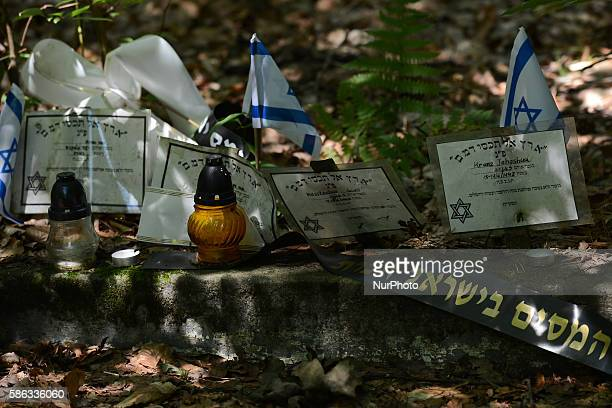 A view of Israeli flags and candles on a common graves a place where 5000 Jews were killed by Nazi Germans in July 1942 in Krakow Poland on August 5...