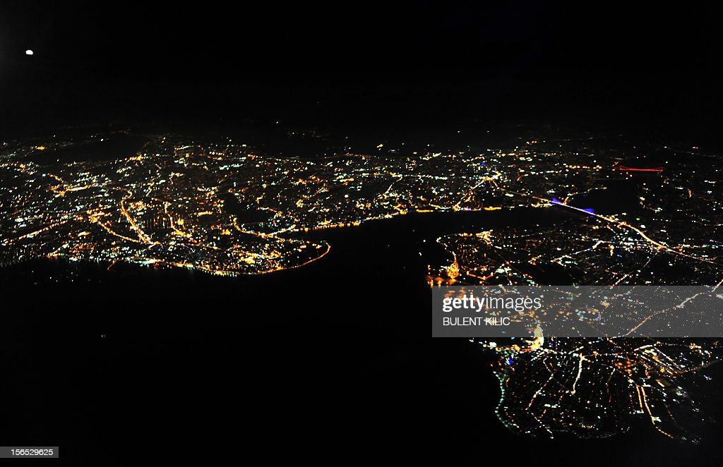 A view of Istanbul and the Bosphorus, also known as the Istanbul Strait, a navigable channel of water which connects the Black Sea with the Sea of Marmara, on November 16, 2012, as seen from an airplane flying over Istanbul. The Bosphorus is considered as the physical and geographical boundary between Europe and Asia. AFP PHOTO / BULENT KILIC