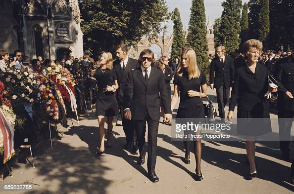 View of Jackie Stewart and his wife Helen attending the funeral of German born Austrian racing driver Jochen Rindt killed competing in the Italan...