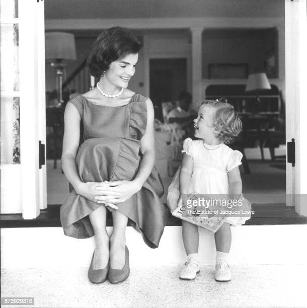 View of Jacqueline Kennedy and her daughter Caroline as they sit sidebyside and share a laugh Hyannis Port Massachusetts August 1960 The photo was...