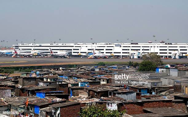 A view of Jari Mari slum and Mumbai International Airport in Mumbai India