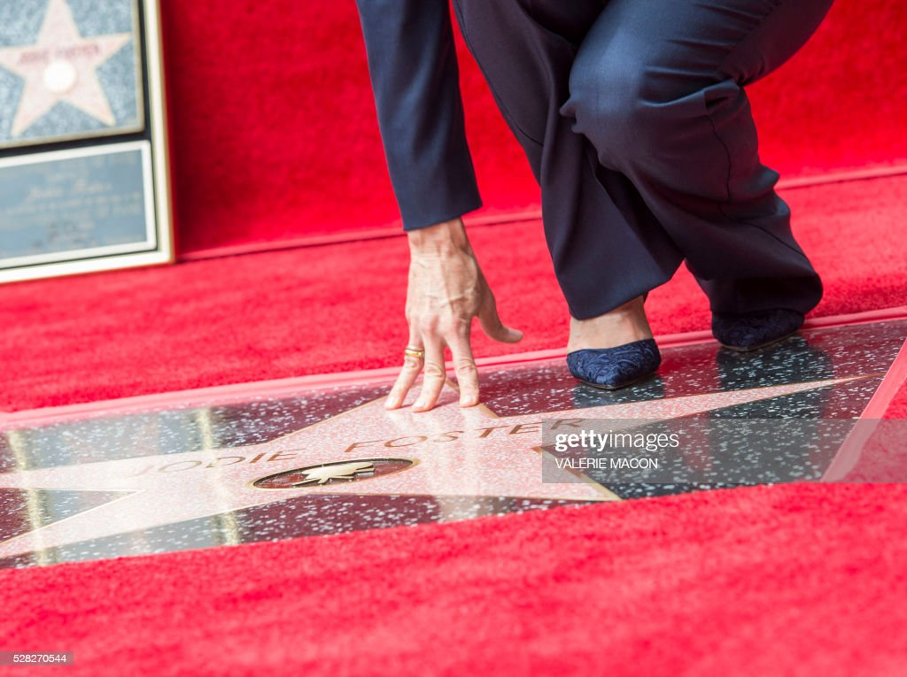 View of Jodie Foster's feet on her star at the Hollywood Walk of Fame ceremony honoring her with a star, in Hollywood, California, on May 4 2016. / AFP / VALERIE