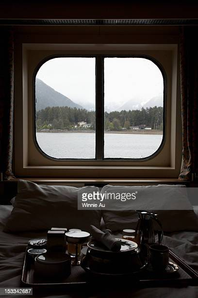 View of Juneau, Alaska thru bedroom window of a passenger ship