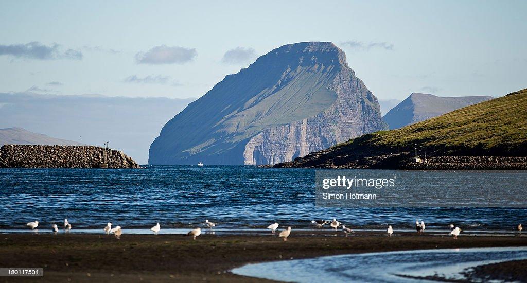 A view of Koltur island from the port basin of Midvagur on September 7 2013 in Midvagur Faroe Islands
