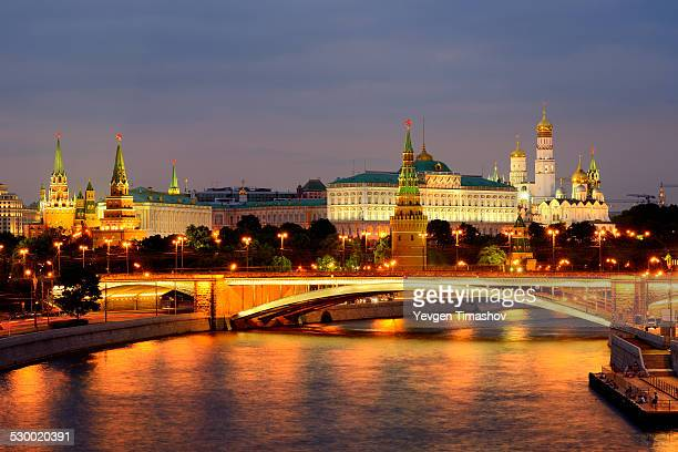 View of Kremlin towers and the Bolshoy Kamenny bridge over Moskva river at night, Moscow, Russia