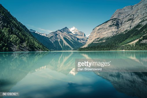 View of lake, forests and snow capped mountain, British Columbia, Canada