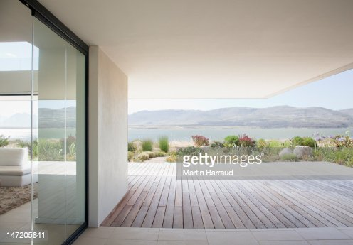 View of lake from patio of modern house : Stock Photo