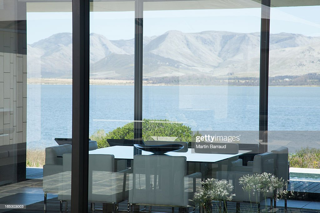 View of lake from window of modern house : Stock Photo