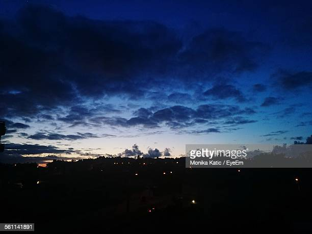 View Of Landscape Against Cloudy Sky At Night