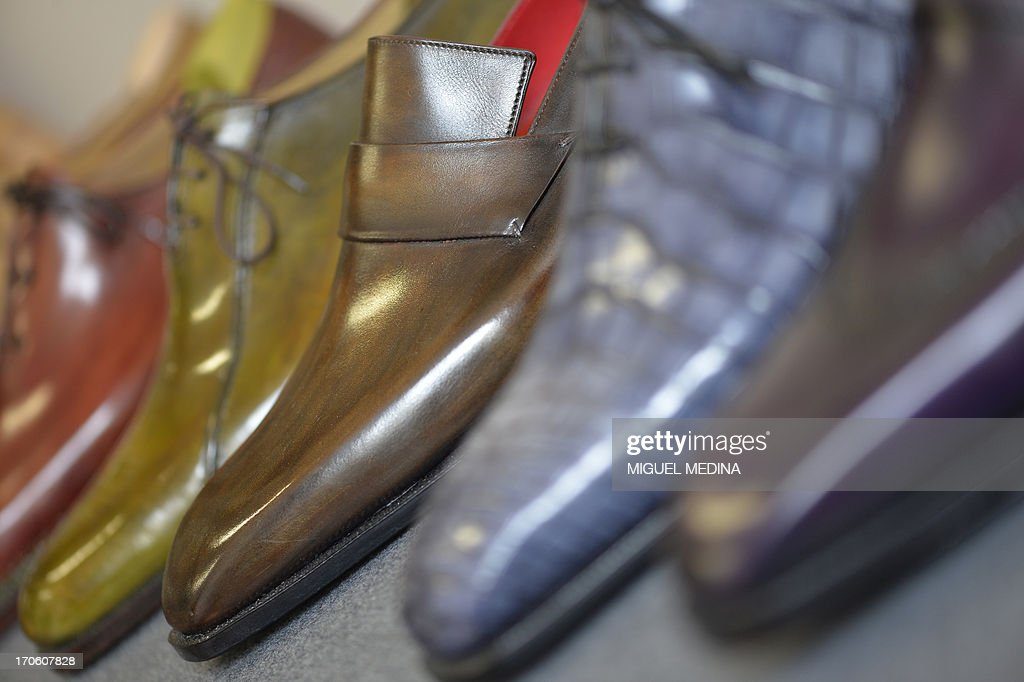 View of leather shoes displayed in the workshop of luxury brand Berluti in Paris on June 15, 2013. Berluti operates as made-to-measure footwear, in particular mens boots and ready-to-wear.