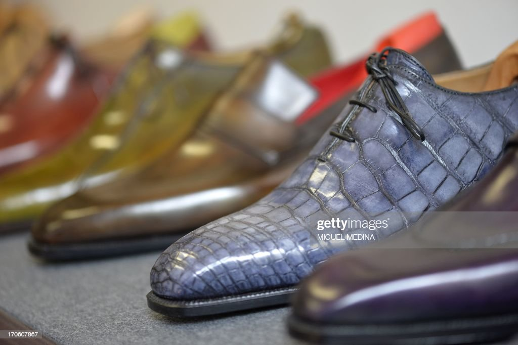 View of leather shoes displayed in the workshop of luxury brand Berluti in Paris on June 15, 2013. Berluti operates as made-to-measure footwear, in particular mens boots and ready-to-wear. AFP PHOTO / MIGUEL MEDINA
