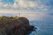 View of lighthouse on headland, Kaua'i, Hawaii, USA