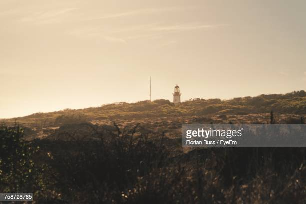 View Of Lighthouse On Landscape Against Sky
