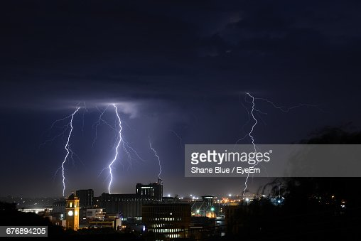 View Of Lightning Over City At Night