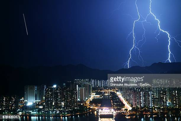 View Of Lightning Strike Above Built Structures
