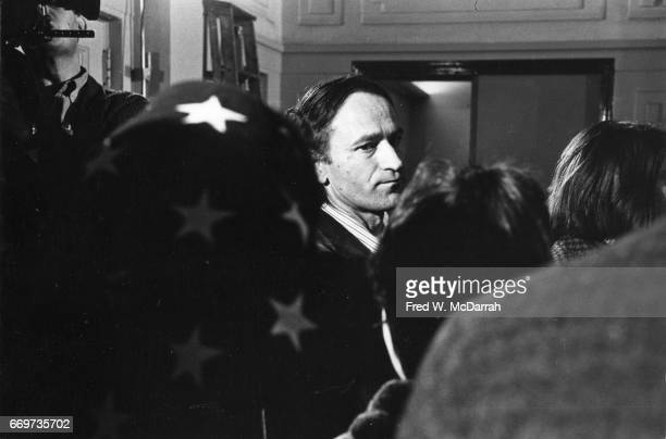 View of Lithuanian American avantgarde film director Jonas Mekas among a group of people at an unspecified event New York New York December 2 1965