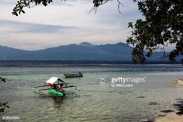 View of Lokon Volcano and Manado from Bunaken Island