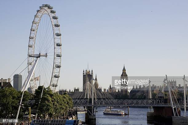 View of London from the Southbank shows London Eye Big Ben Houses of Parliament England UK