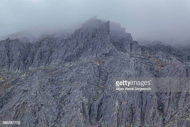 View of low cloud over rugged mountains, Ural mountains, Russia