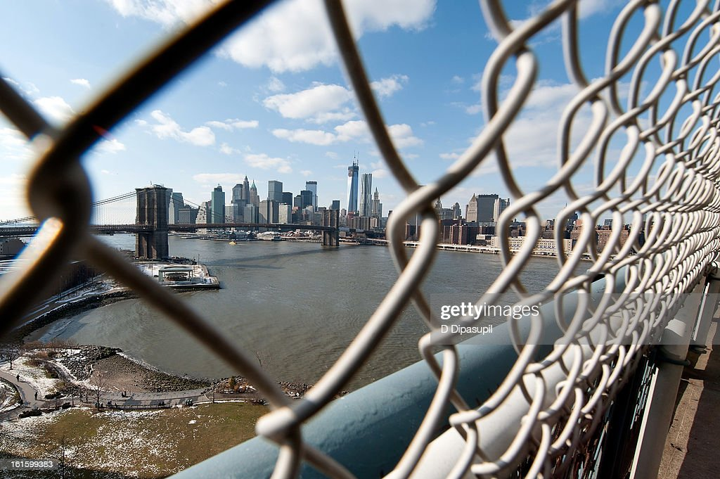 A view of lower Manhattan and the Brooklyn Bridge as viewed from the Manhattan Bridge on February 12, 2013 in New York City.