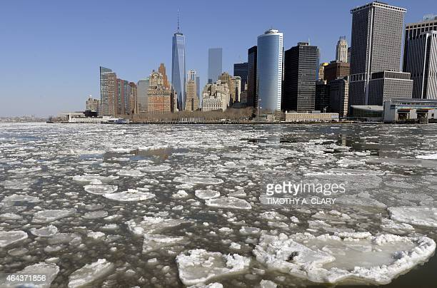 A view of Lower Manhattan from the Staten Island Ferry February 25 2015 as the New York Harbor is filled with large chunks of ice AFP PHOTO / TIMOTHY...