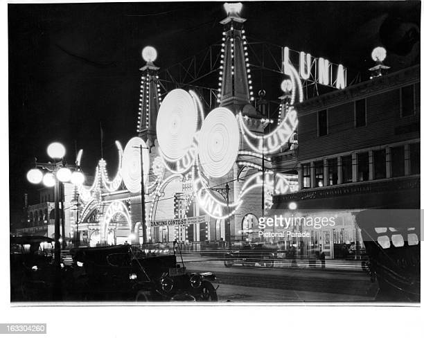A view of Luna Park at night lit up with colorful lights in Coney Island New York 1955