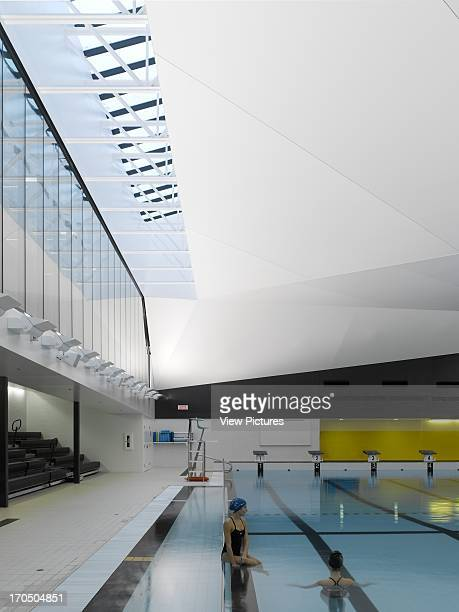 View of main pool bleacher seating roof light with two swimmers Centre Aquatique St Hyacinthe St Hyacinthe Canada Architect acdf* Architecture 2012