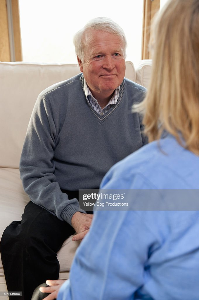 View of man on couch talking to therapist
