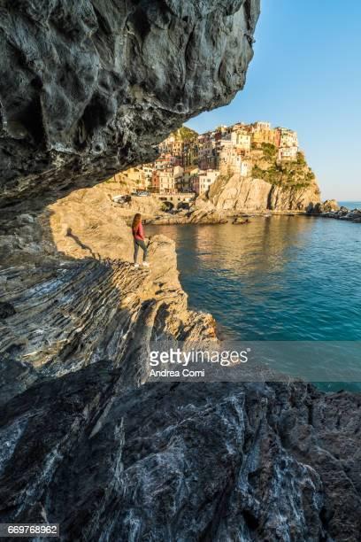 View of Manarola from the rocks at sunset. Manarola, Cinque Terre, La Spezia, Liguria