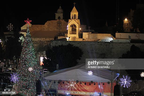A view of Manger Square and the Church of the Nativity as people gather for Christmas eve celebrations in the biblical West Bank city of Bethlehem...