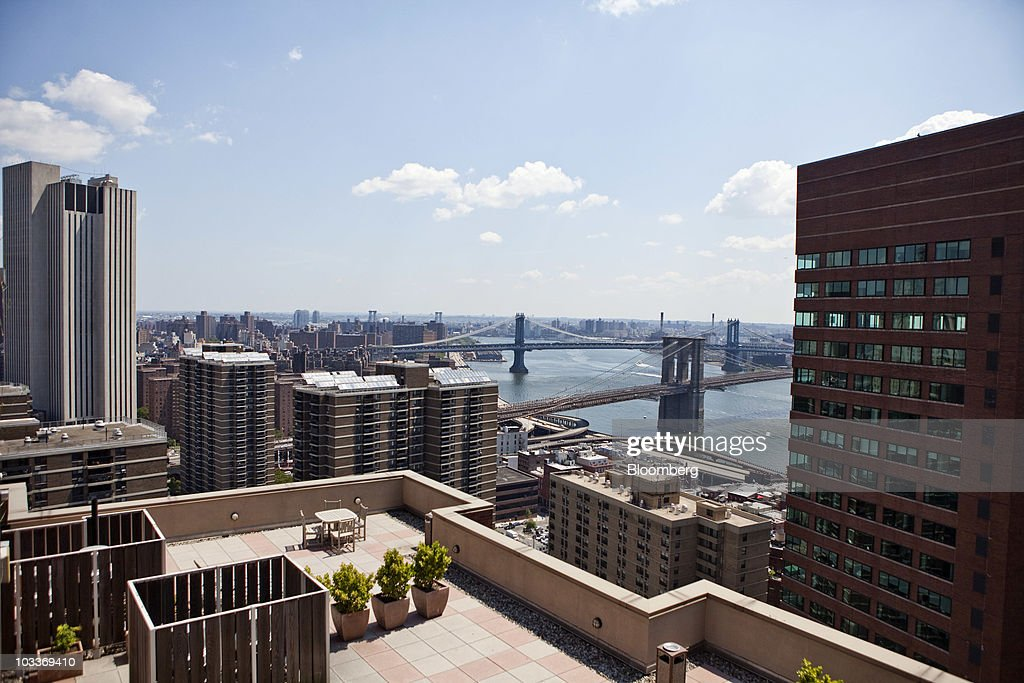 A view of Manhattan Bridge, rear, and Brooklyn Bridge, as seen from the roof terrace of the 99 John Deco Lofts condo building in New York, U.S., on Friday, July 30, 2010. In March, the Federal Housing Administration (FHA) agreed to insure mortgages made at the 442-unit conversion project, allowing buyers to acquire an apartment with a down payment of as little as 3.5 percent. The development had 10 units go into contract with FHA backing, but the agency suspended its support for the building on August 3. Photographer: Ramin Talaie/Bloomberg via Getty Images