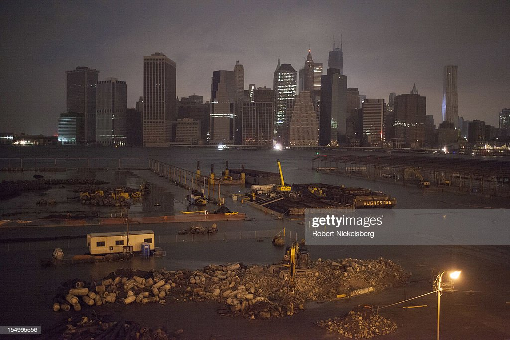 A view of Manhattan from along Brooklyn Heights' Promenade after Hurricane Sandy hit, on October 29, 2012 in the Brooklyn borough of New York. Electricity in Lower Manhattan had been turned off. The storm, which threatens 50 million people in the eastern third of the U.S., is expected to bring days of rain, high winds and possibly heavy snow.