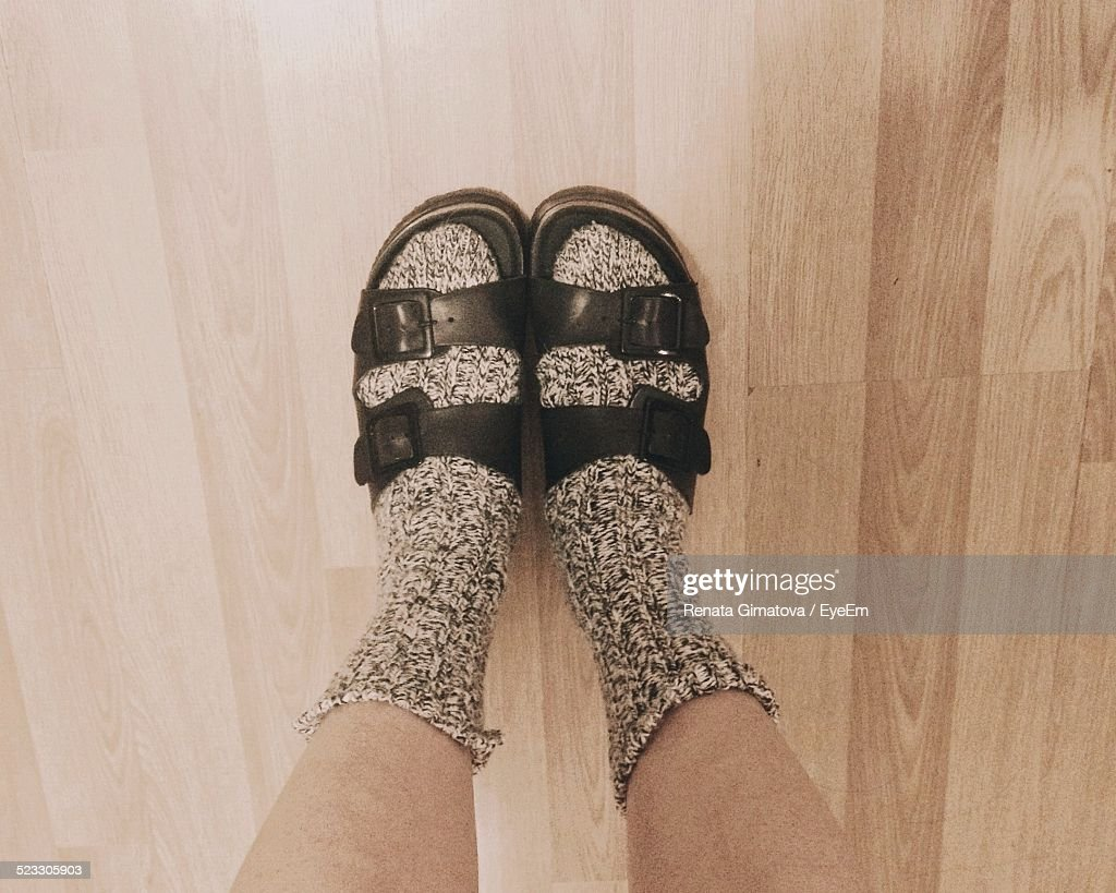View Of Mans Feet In Woolen Socks And Sandals