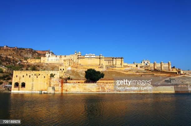 View Of Maota Lake By Amber Fort Against Clear Blue Sky