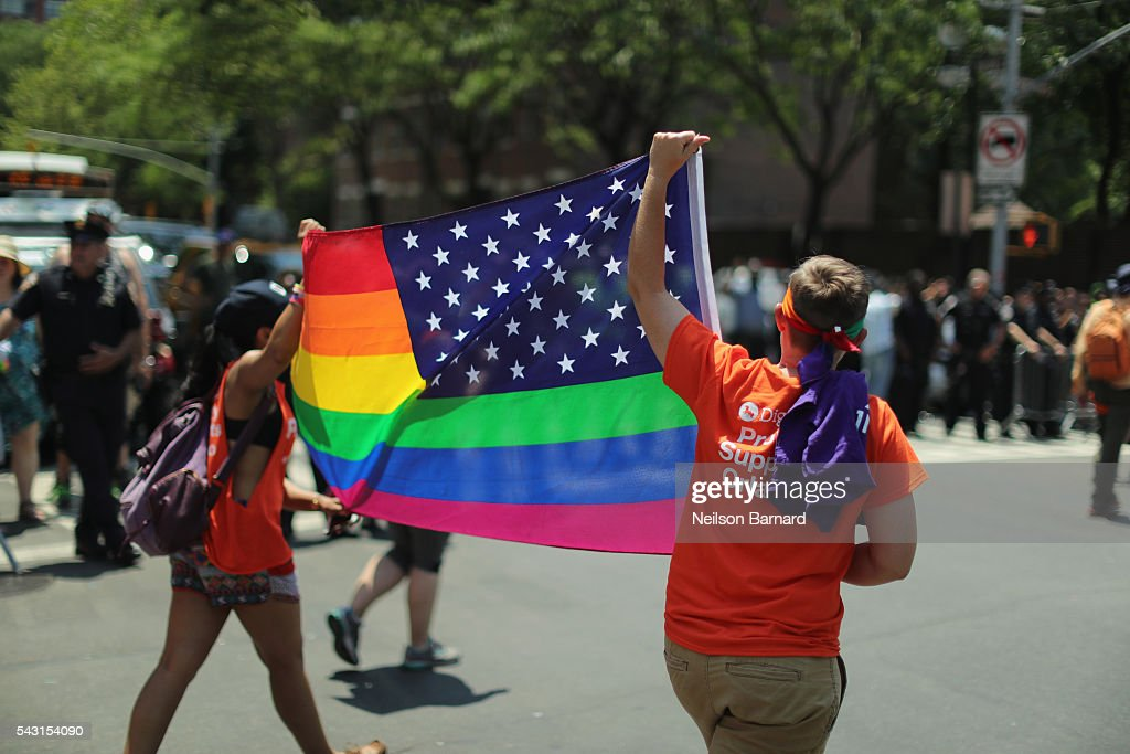 A view of marchers with a rainbow flag during the New York City Pride 2016 march on June 26, 2016 in New York City.