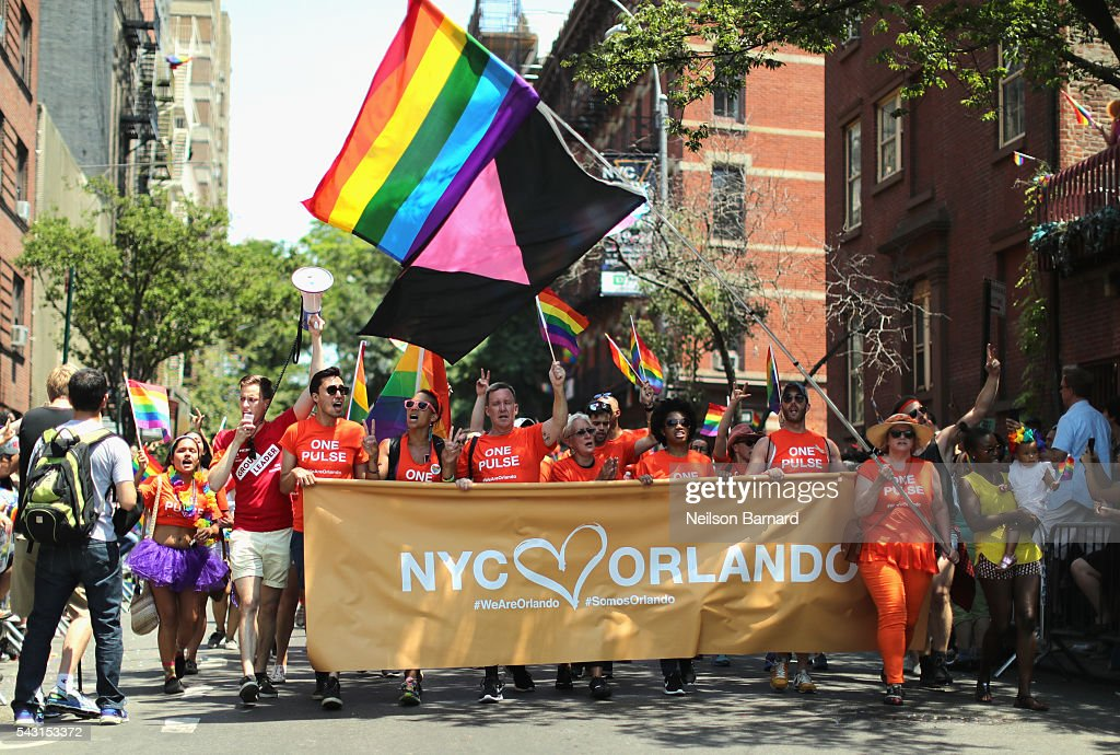 A view of marchers with a tribute to Orlando sign during the New York City Pride 2016 march on June 26, 2016 in New York City.