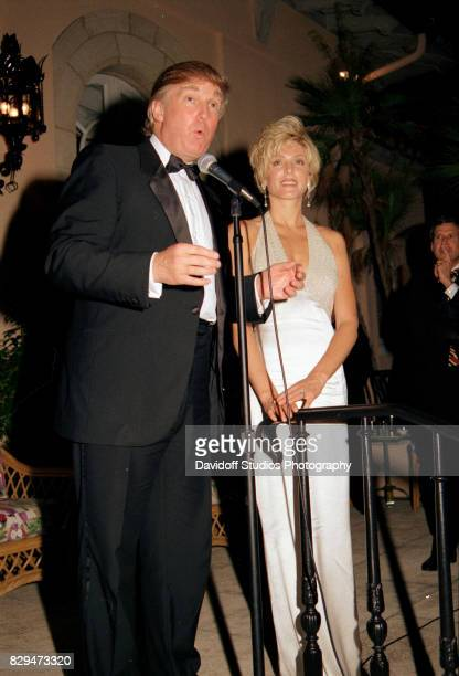 View of married American couple real estate developer Donald Trump and actress Marla Maples on stage during the official opening party of the...
