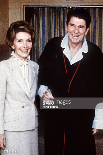 This photo taken on April 1981 shows President Reagan with Mrs Nancy Reagan inside George Washington University Hospital four days after the...