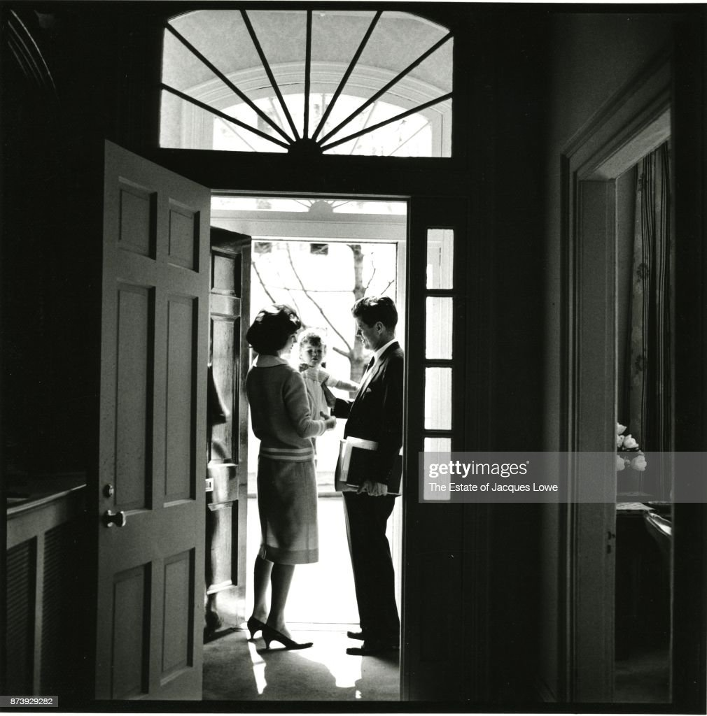 Like any other father leaving for work - an everyday moment from an extraordinary family as JFK says goodbye to his wife and daughter as he leaves their D.C. home