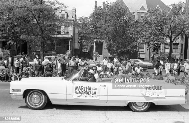 View of Martha Reeves of Martha and the Vandellas as she rides an open convertible during the Bud Billiken Day parade Chicago Illinois mid to late...